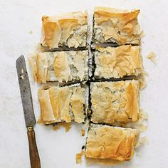 Spinach Pie with Goat Cheese, Raisins, and Pine Nuts Recipe Main Dishes with olive oil, minced onion, fresh spinach, golden raisins, goat cheese, pinenuts, kosher salt, ground black pepper, phyllo dough, cooking spray