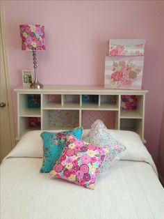 Bed with storage nooks. Handmade pillows. Coordinating lampshade.
