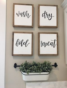 Add the perfect farmhouse touch to your laundry room or Mudroom with this set of four signs! Size: Approximately 12 tall by 10 wide Details: Reclaimed wood frame with walnut stain, white background and black hand painted lettering that features the words wash, dry, fold, repeat. When ordering, please keep in mind no two pieces of wood are the same, and no two signs will appear identical in stain color, distressing, or natural detailing of the wood. Each sign is unique in characteristics and…