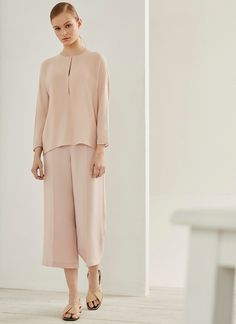 Loose-fitting blouse that has a crew neck and elegant slits down the center front. It has three-quarter-length dolman sleeves and a single-button keyhole opening in the back. Shirt Blouses, Shirts, Duster Coat, Crew Neck, Silk, Elegant, Jackets, Shopping, Women