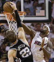 Miami Heat small forward LeBron James (6) blocks a shot by San Antonio Spurs center Tiago Splitter (22) of Brazil, during the second half of Game 2 of the NBA Finals basketball game, Sunday, June 9, 2013 in Miami. The Miami Heat won 103-84. (AP Photo/Lynne Sladky)