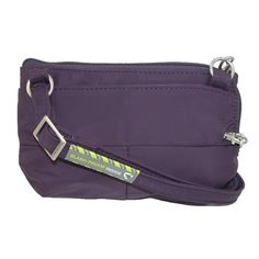 This convertible crossbody/waist pack is packed with security, organization and style. The slash proof strap adjusts from 29-53 inches and can be worn around the waist as a fanny pack or used as a crossbody or shoulder bag. The main compartment features RFID blocking card and passport slots in addition to a roomy multi purpose pocket ideal for phones. It also features a front zip pocket and rear pocket with snap closure. A tethered key clip with LED light is sewn into the main compartment.