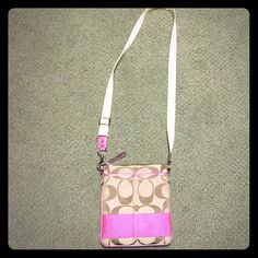 Adorable pink Coach cross body bag One of my classic bags! Love it so much just don't use it as much as I used to. Adjustable strap. Pink inside of bag Coach Bags Crossbody Bags