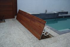 Hinged frame door over pool cover, timber planks over. Swimming Pools Backyard, Pool Decks, Pool Cover Roller, Pool Organization, Hidden Pool, Timber Planks, Backyard Water Feature, Pool Construction, Pool Equipment