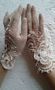 """I propose to make gloves """"Ligne de fleurs"""" to order . Choose the size and shade at will! Write me a message about your choice of colors and size if they are not in the table . The photo shows ivory gloves. Crochet Gloves Pattern, Crochet Motifs, Thread Crochet, Crochet Crafts, Crochet Stitches, Knit Crochet, Crochet Leaves, Diy Crafts, Antique Lace"""