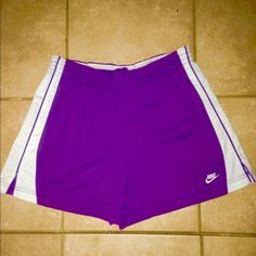 NIKE LADIES RUNNING SHORTS Nike Dri fit  purple n white gym shorts with splits on side n wide waistband n drawstring... Size 8-10 ...Excellent condition inseam 4 inches ...Length from waist to hemline 14 inches... Nike Shorts