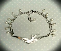 Adjustable antique silver soaring bird bracelet w/ tiny white glass pearls | Two Birds Creations on Facebook