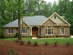 Here is a  ranch house plan  worth your consideration.  The inviting front porch features an 11' high ceiling as does the entry. Just beyond the entry are stairs leading to an expansive bonus room with its own bath. The 16'x19' family room has a 11' ceiling and a rear window wall with French doors leading to the enormous covered porch brightened by 6 skylights. The angled kitchen, dining and hearth room are open, crowned with vaulted ceilings, and su…
