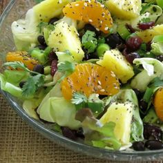 Caribbean Salad with Honey Lime Dressing -Caribbean salad drizzled with honey lime dressing made famous by Disney's 'Ohana restaurant. Pineapple, mandarin oranges, dried cranberries, cilantro, green onions and more will tantalize your taste buds.