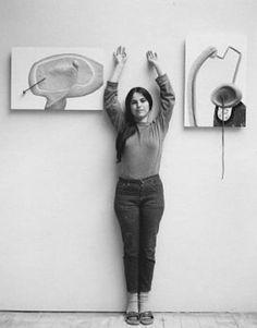 Eva Hesse (1936-1970) standing with her work