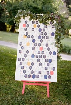 Brides.com: . For a whimsical look that still feels fresh, consider an escort card display like this honeycomb pattern from Enjoy Events Co.