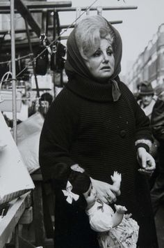 So as to define the East End of London, this photo does it effortlessly. Looks like she's had a tough life.  Dorothy Bohm; Petticoat Lane Market, East End, London circa 1960