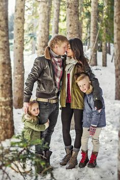 Winter family photos, couple, husband, wife, daughter, son, brother, sister, romantic, romance, embrace, snow, scarf, trees, sun, Christmas, holiday.