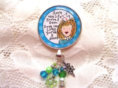 Green and turquoise retractable id badge reel by Tornedgesemporium