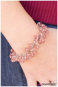 Pixie Dust Item #: P9WH-PKSV-001HH Dozens of translucent light pink beads with faceted edges sway from a dainty silver chain for a sophisticated elegant look that will melt your heart. Features an adjustable clasp closure.  Sold as one individual bracelet.