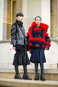 Sacai was one of the most well-hailed collections of the season and these two show-goers prove why it's a favorite.