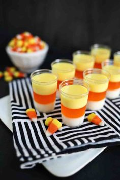These candy corn jello shots are a Halloween party must-have! (Spooky Halloween Cocktails)