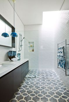 """In the ensuite, Moroccan floor tiles from [Onsite Supply+Design](http://www.onsitesd.com.au/?utm_campaign=supplier/ target=""""_blank"""") and a Verner Panton pendant from [Great Dane Furniture](http://www.greatdanefurniture.com/?utm_campaign=supplier/ target=""""_blank"""") are attention grabbing. """"But the feature I love is the heated pad behind the mirror that prevents steam build up,"""" says Alastair.: [object Object]"""