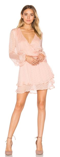 Daliah mini dress by Free People. 100% rayon. Hand wash cold. Fully lined. Surplice neckline. Elasticized waist. FREE-WD1135. OB545702. Free People inv...