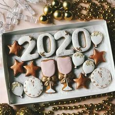 If you are planning on celebrating in any kind of way, here are 20 happy new year cookies for your beloved in New Year New You, Happy New Year 2020, New Years Cookies, New Year's Cake, Nye Party, Cookie Designs, Joy And Happiness, New Years Eve Party, Holiday Cookies