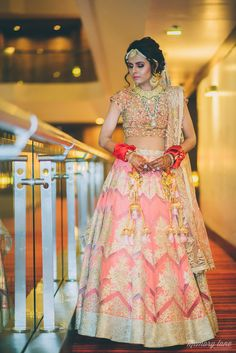 Real Indian Weddings - Monicka and Tehseen | WedMeGood | Peach and Gold Bridal Net Printed Lehenga with a Gold Embroidered Blouse #wedmegood #realwedding #gold #peach