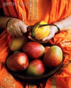 Woman peeling mango