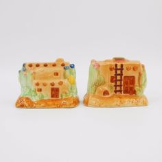 SOLD - Pre-owned collectible gloss glazed porcelain ceramic figural novelty salt and pepper shakers set. Two piece set of western style adobe or pueblo houses.  Brown houses with cactus and ladder accents. #SaltAndPepperShakers #House