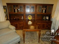 Haverty's seven piece executive suite with filing cabinets, hidden keyboard trays, lighted hutches and a return. Set it up how you like. The return does not have to come out the center. Measures 138*84*83. Retail $13,300.