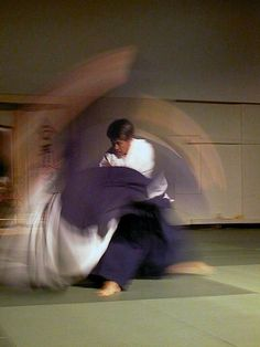 "Aikido 合気道 - a Japanese martial art developed by Morihei Ueshiba as a synthesis of his martial studies, philosophy, and religious beliefs. Aikido is often translated as ""the Way of harmonious spirit."" Ueshiba's goal was to create an art that practitioners could use to defend themselves while also protecting their attacker from injury."