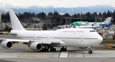 This Boeing 747-8 Intercontinental jetliner, the first VIP-configured aircraft, rolls out for an undisclosed customer for takeoff from Paine Field in Everett, Washington. Time mag says it's the next Air Force One.