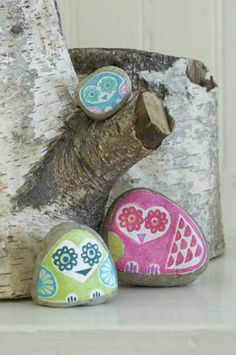 This painted rock owl family is ready for Spring.
