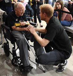 Speaking out: Sgt Baker, 102, thanked Harry, 33, for his work with military personnel as he made a speech which was shown on the big screen at the event