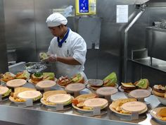 Chef on Holland America Nieuw Amsterdam prepares meals at the pool side grill Holland America Cruises, Holland America Line, World Cruise, Alaskan Cruise, Cruise Travel, Food Preparation, Food Dishes, Food Inspiration, Food To Make