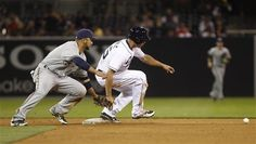 Game #25 5/1/2012: San Diego Padres' Will Venable bounces up from his slide as the ball gets away from Milwaukee Brewers shortstop Alex Gonzalez on a stolen base during the third inning of a baseball game Tuesday, May 1, 2012 in San Diego. (AP Photo/Lenny Ignelzi)