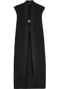 Black silk Open sides, longer back hem, reinforced stretch-cotton trims Snap-fastening tab at split front 100% silk; trims: 97% cotton, 3% elastane Dry clean