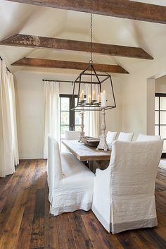 Simple rustic dining - love the lantern pendant