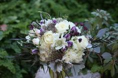 Fleurie, Reedley, California - bridal bouquet with white and purple flowers.