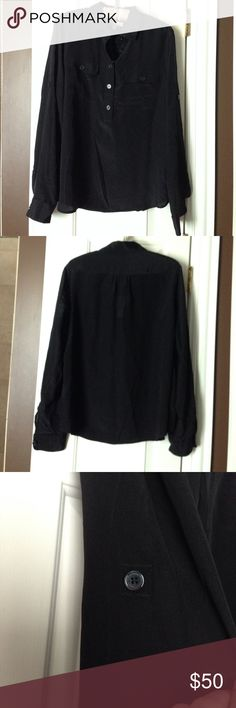 Brand New Banana Republic Top Black blouse. Long sleeve or can be worn three-fourths sleeve. Has button on sleeve to secure sleeve when rolled up. Brand new perfect condition. 100% Silk Banana Republic Tops Blouses