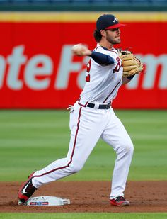 Dansby Swanson Photos Photos - Dansby Swanson #2 of the Atlanta Braves turns a double play over Martin Prado #14 of the Miami Marlins in the first inning at Turner Field on September 14, 2016 in Atlanta, Georgia. - Miami Marlins v Atlanta Braves