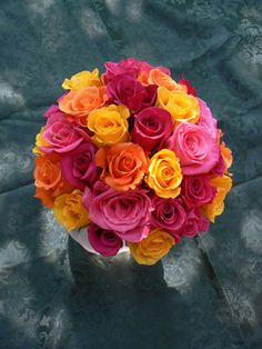 happy bouquet... bright pink, orange and yellow roses...wedding bouquet