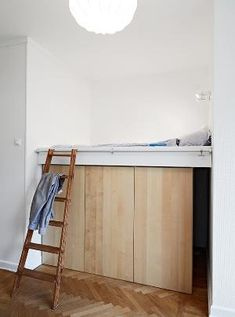instead of a traditional closet. Make it a bed niche and have storage underneath. by maritza