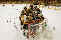 NASHVILLE, TN - JUNE 11: Matt Murray #30 of the Pittsburgh Penguins celebrates with teammates after defeating the Nashville Predators 2-0 to win the 2017 NHL Stanley Cup Final at the Bridgestone Arena on June 11, 2017 in Nashville, Tennessee. (Photo by Justin K. Aller/Getty Images)