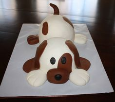 This cake was totally inspired by another wonderful puppy dog cake I saw here on CC by justkist. Its decorated with MMF and chocolate fondant for the brown.
