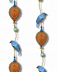 """Colour – Cobalt blues and burnt orange  Inspired by animals and narrative jewellery pieces from the famed Victoria and Albert Museum archives, """"Pendant & Ornamental Birds"""" climbs, almost meanders upwards. The fine hand drawn work within the birds' feathers defines nature as precious. The bird clutches onto a pearl and grand ornamental pendants hang and swoop below. Full of intrigue, this wallpaper will be sure to enhance any space large or small.  10 linear meters per roll  Total coverage..."""
