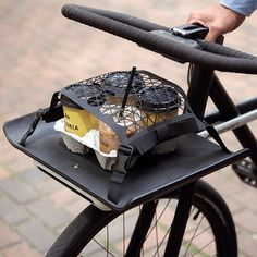 DENNY #SEA: The front of the bike frame functions as a carry tray with a…
