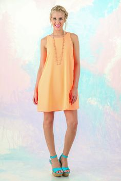 Dress up or dress down in this tangerine tank dress! The perfect pop of color! Love, love, love!