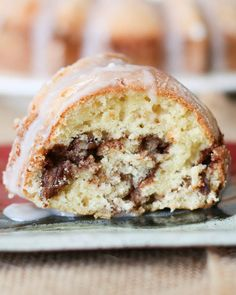 Glazed Cinnamon-Pecan Coffee Cake - or cinnamon roll cake using a bundt cake pan. Cake is filled with a cinnamon/sugar filling and is baked and then drizzled with a sugary icing.