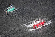 Amphibious cars on the Moselle near Traben-Trarbach, Germany for the rally Amphib 2014.