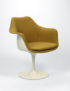 RISD Museum: Eero Saarinen, designer, American, 1910-1961; Knoll International, Inc., manufacturer. American, 1938-. Tulip Armchair (model 150), 1955-1956. Fiberglass-reinforced plastic, cast aluminum, wool. 81.3 x 66 cm (32 x 26 inches). Gift of The Athenaeum Bookbinders 1998.32