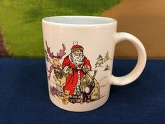 Vintage Porcelain Christmas Mug Cup Designed With Santa Claus Reindeer And Christmas Toys Gifts by AdoptAKeepsake on Etsy